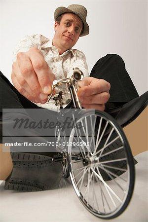 Man Riding a Very Small Bike