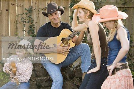 Famille jouant de la musique country et la danse