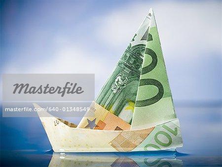 Paper sailboat made of Euro banknotes