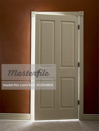 Door slightly ajar with light