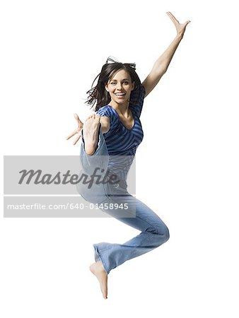 Woman kicking and smiling