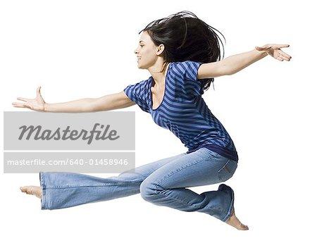 Woman jumping profile
