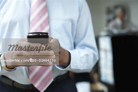 Businessman Holding Electronic Organizer