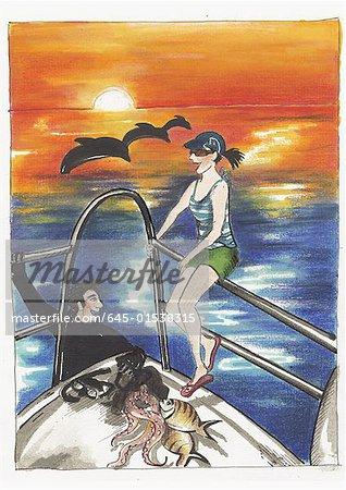 Young couple having fun on sailboat