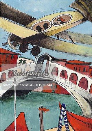 Touristes en vol petit avion au-dessus du pont du Rialto sur le Grand Canal de Venise