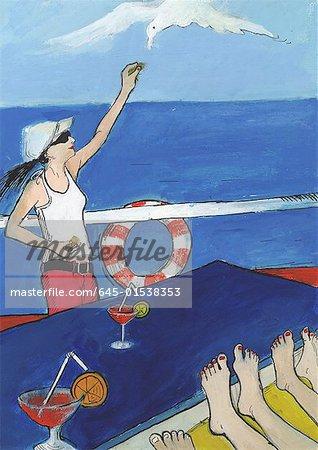 Femme sur le pont du bateau de croisière, l'alimentation de la Mouette