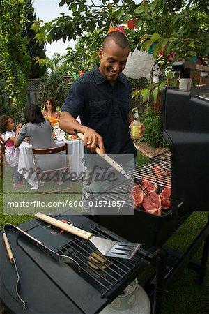 Mann am Grill