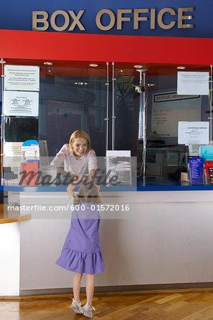 Girl Buying Movie Ticket