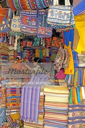 Guatemala, Antigua, market, multicoloured fabrics