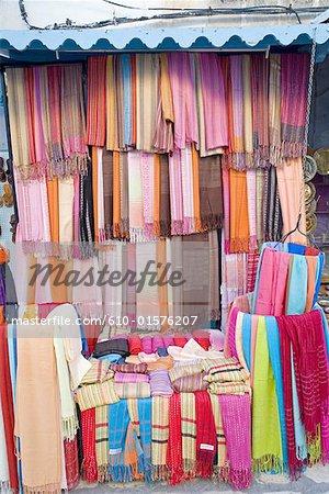 Tunisia, Kairouan, selling multicoloured scarfs