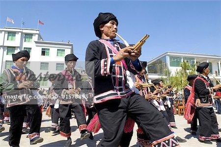China, Yunnan, Lancang, Lahu men playing the traditional flute