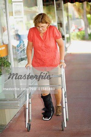 Woman With Broken Ankle Using Walker