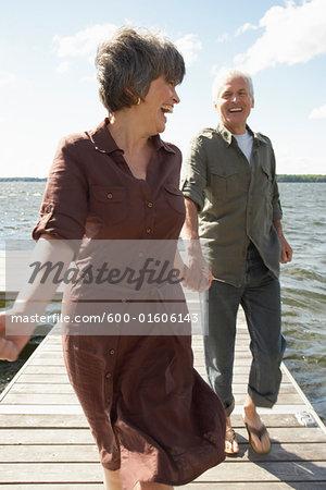 Couple Walking on Dock