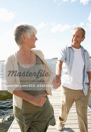 Couple Walking along Dock