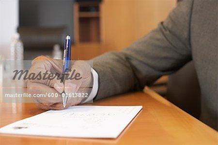 Close-up of Businessman Writing