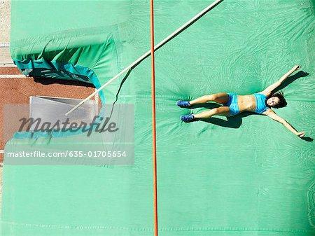 Athlete on a crash mat after pole vault