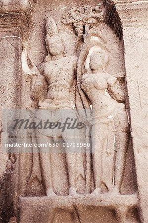 Statues of lord Shiva and goddess Parvati carved in a cave, Ellora, Aurangabad, Maharashtra, India