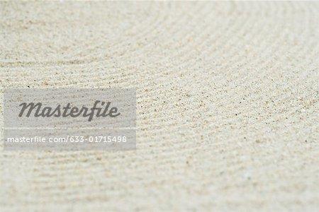 Modèle tracée dans le sable, extreme close-up