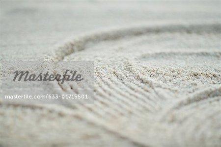 Modèle tracée dans le sable, plein cadre, très gros plan