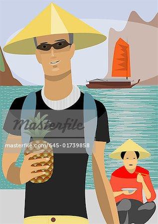 Jeune homme, portant chapeau asiatique sur la plage avec une femme asiatique en arrière-plan