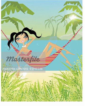 Femme reposante sur un hamac au bord de la plage