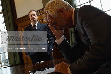 Businessmen in Large Boardroom