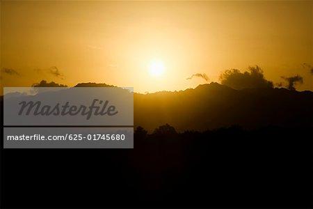 Sun over a mountain range, Nawiliwili Beach Park, Kauai, Hawaii Islands, USA