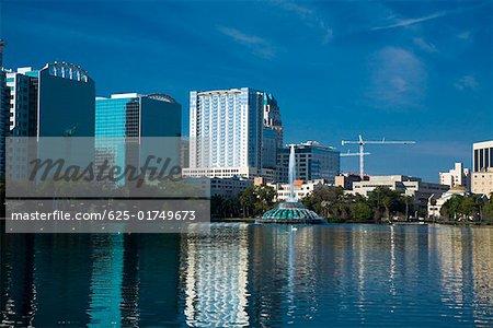Reflection of buildings in water, Lake Eola, Orlando, Florida, USA