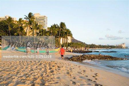 Tourists on the beach, Waikiki Beach, Honolulu, Oahu, Hawaii Islands, USA