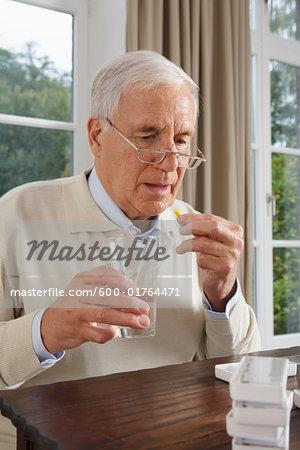 Man Taking Medication