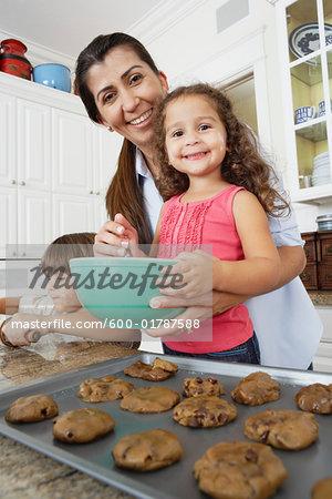 Mother and Children Baking Cookies