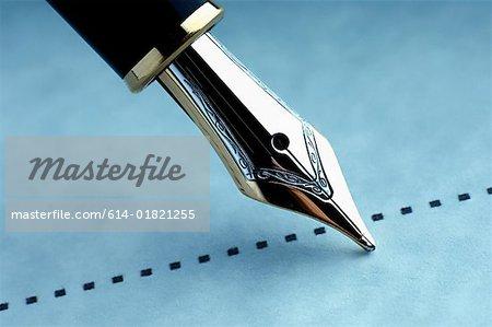Signature sur la ligne pointillée