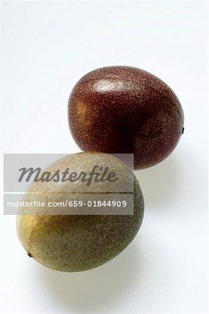 Two whole passion fruits (Purple granadilla)