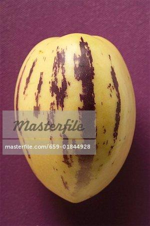 Pepino melon on purple background