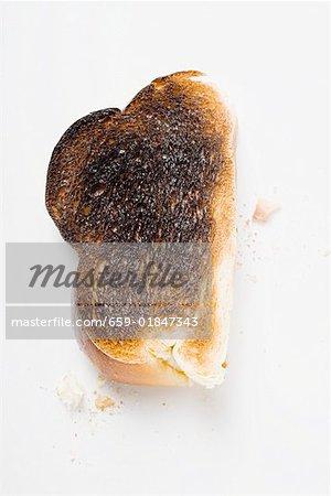 Scheibe verbranntem toast