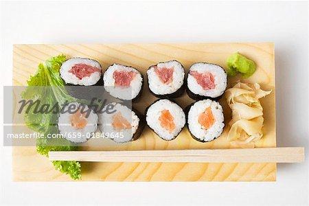 Maki sushi with tuna and salmon on sushi board