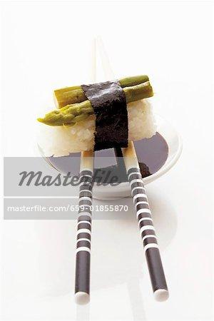 Asparagus nigiri sushi with soy sauce and chopsticks