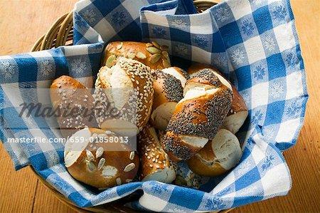 Assorted pretzel rolls in bread basket