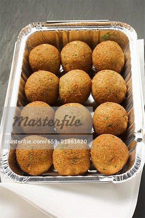 Falafel (chick-pea balls) in aluminium dish