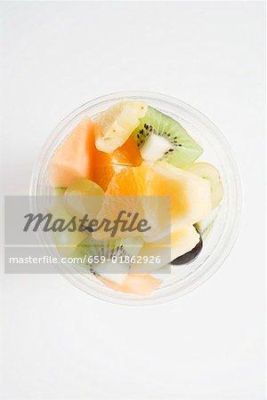 Fruit salad in a plastic beaker (overhead view)