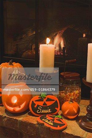 Halloween decorations (pumpkin lanterns, candles, place cards)