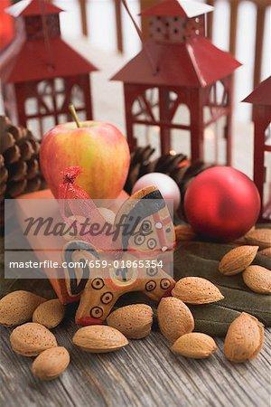 Gingerbread horse, almonds, apple Christmas baubles, lanterns