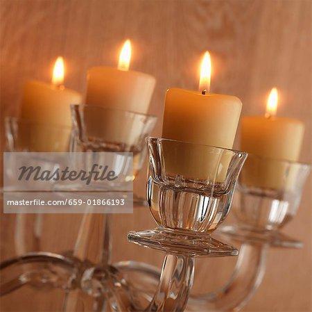 Burning candles in candelabrum