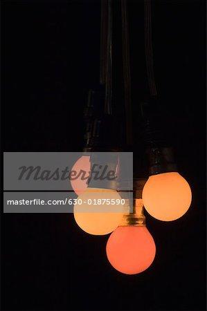 Close-up of four light bulbs