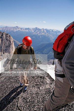 Rock Climbers on Mountain Peak, Bugaboo Mountains, British Columbia, Canada