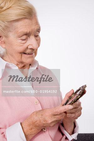 Woman Looking at Photograph