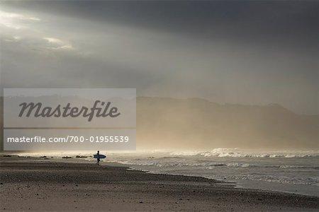 Surfer on Beach, Mal Pais, Puntarenas Province, Nicoya Peninsula, Costa Rica