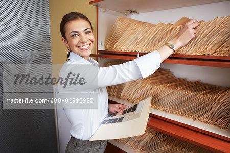 Woman Filing Medical Documents