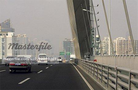 China, Shanghai, bridge over Huangpu River , driving on urban freeway