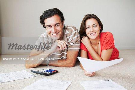 Couple work on home finance